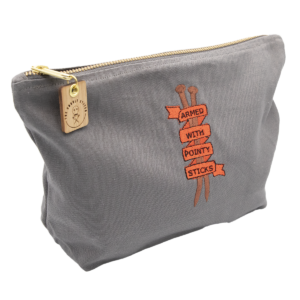 """embroidered cotton pouch bag - ribbon and text """"armed with pointy sticks"""""""