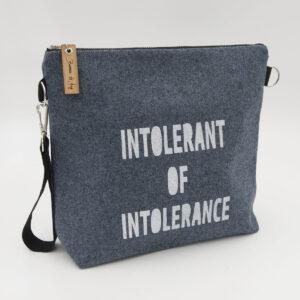 Blue wool felt zipped bag with intolerant of intolerance print