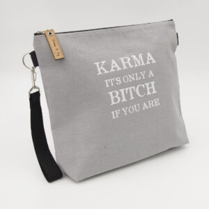 Silver linen zipped bag with karma. It's only a bitch if you are print