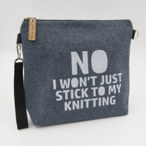 Blue wool felt zipped bag with No I won't stick to my knitting print