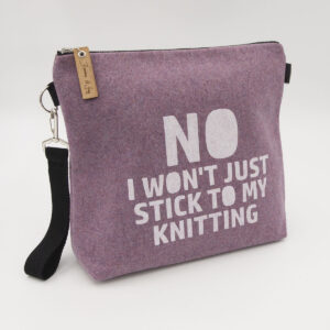 Pink wool felt zipped bag with No I won't stick to my knitting print