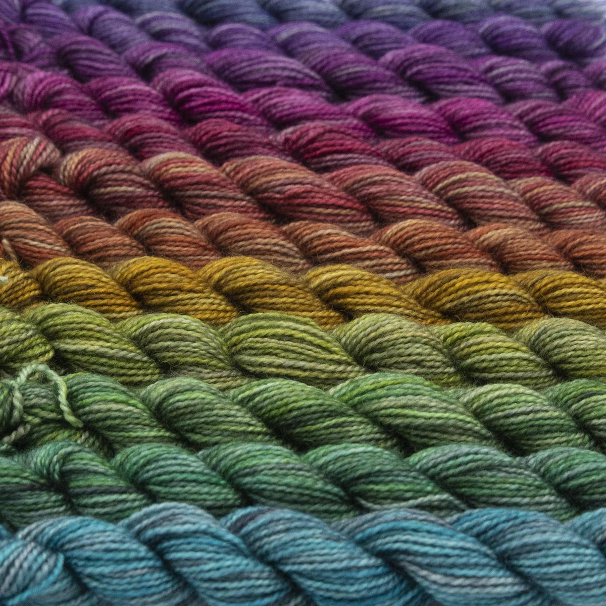 mini skeins of bfl nylon sock yarn in printer ink shades