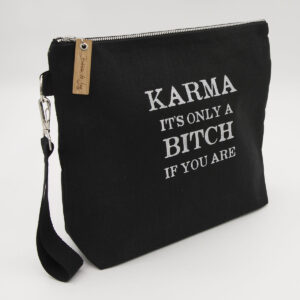 Black linen zipped bag with karma. It's only a bitch if you are print