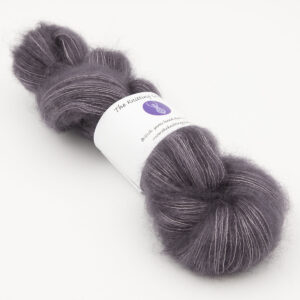 mauve colourway, skein of fluffy kid mohair and silk laceweight yarn
