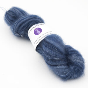 Superhero Genes steel blue colourway, skein of fluffy kid mohair and silk laceweight yarn