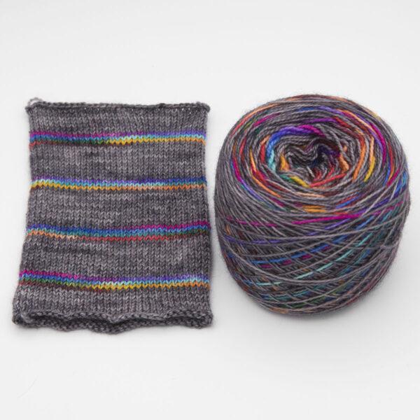 Rainbow on Charcoal colourway Self striping sock yarn, yarn cake