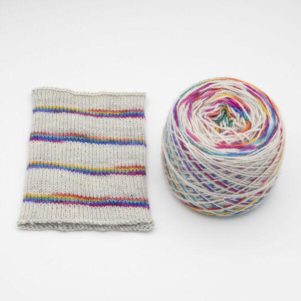 Rainbow on Silver colourway Self striping sock yarn, yarn cake
