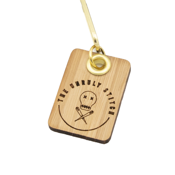 The Unruly Stitch laser engraved bamboo zip tag