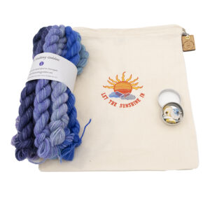 let the sunshine in embroidered project bag with hydragea mini skeins and stitch markers in a tin