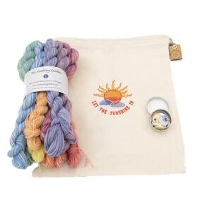 let the sunshine in embroidered project bag with printer ink mini skeins and stitch markers in a tin
