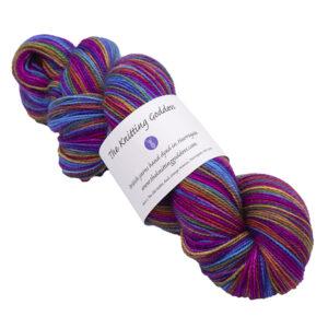 purple rainbow skein of sock yarn
