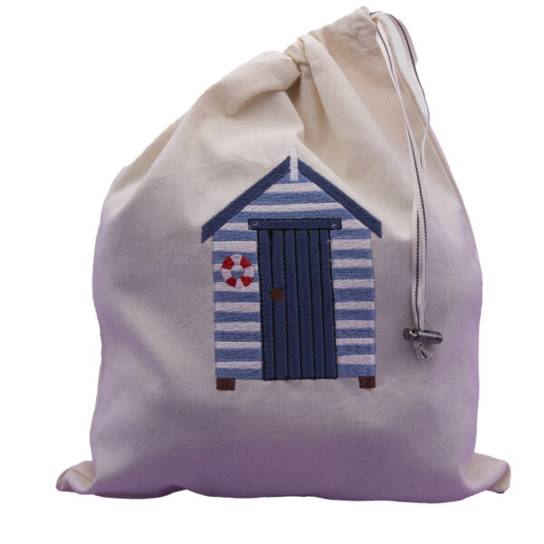 embroidered drawstring bag with beach hut design