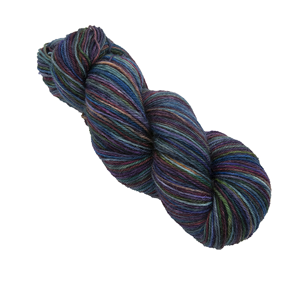 Skein of hand dyed yarn in black rainbow