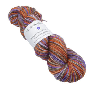 Skein of hand dyed yarn in elegantly rusted (copper, purple and brown)