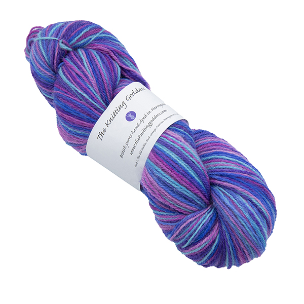 Skein of hand dyed yarn in fuchsia bouquet (pink, purple and turquoise)