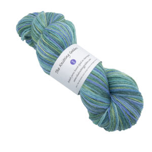 Skein of hand dyed yarn in lavender field (greens and blue)