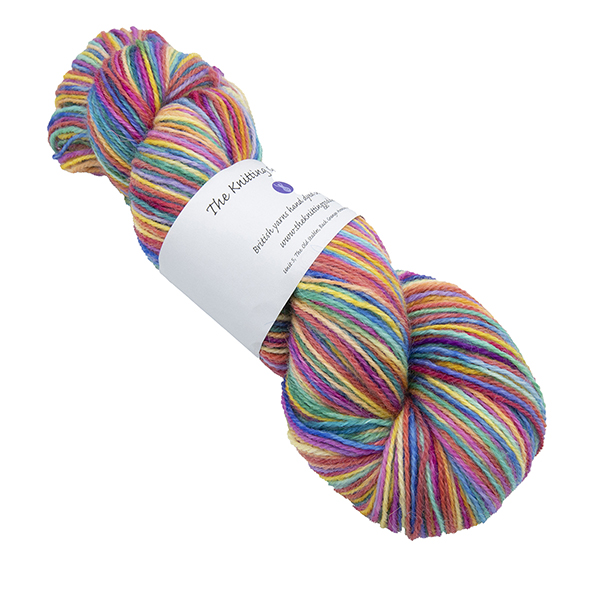 Skein of hand dyed yarn in ultimate rainbow