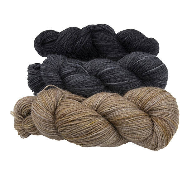 three skeins of hand dyed yarn - silver marigold, charcoal and black