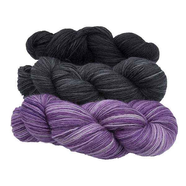 three skeins of hand dyed yarn - silver wisteria, charcoal and black