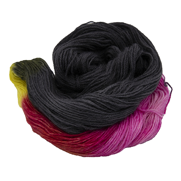 skein of black with yellow and pink colour hand dyed Britsock yarn from The Knitting Goddess. The yarn has not been reskeined so the colours show as blocks. The skein is wound into a coil.