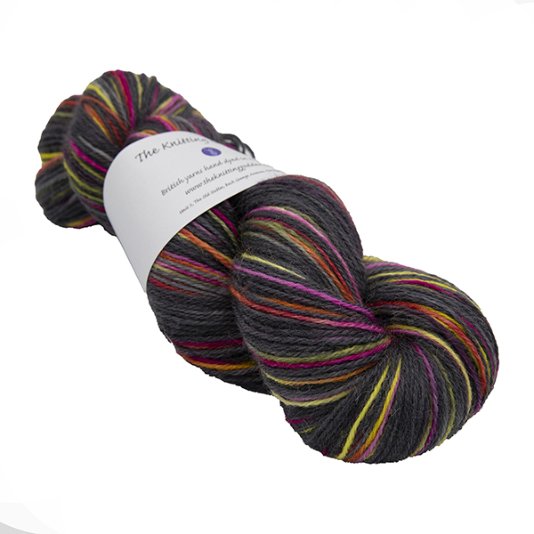 skein of black with yellow and pink colour hand dyed Britsock yarn from The Knitting Goddess