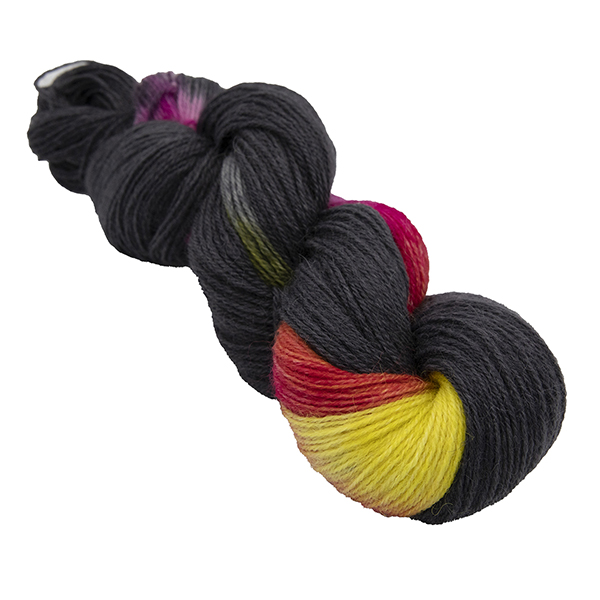 skein of black with yellow and pink colour hand dyed Britsock yarn from The Knitting Goddess. The yarn has not been reskeinsed so the colours show in blocks.
