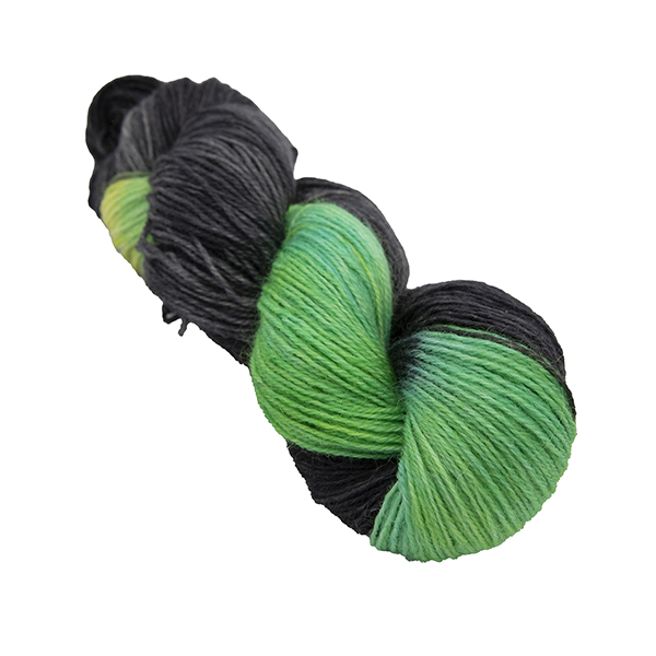 skein of black with turquoise and yellow colour hand dyed Britsock yarn from The Knitting Goddess