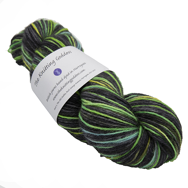 skein of black with turquoise and yellow colour hand dyed Britsock yarn from The Knitting Goddess with ball band