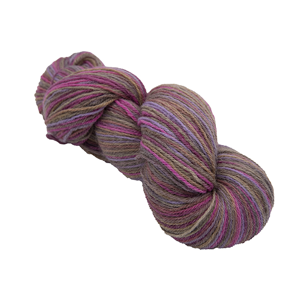 skein of chcolate box colour hand dyed Britsock yarn with browns, pink and purple from The Knitting Goddess