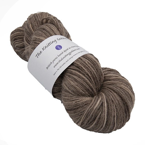 skein of chocolate brown colour hand dyed Britsock yarn from The Knitting Goddess with ball band