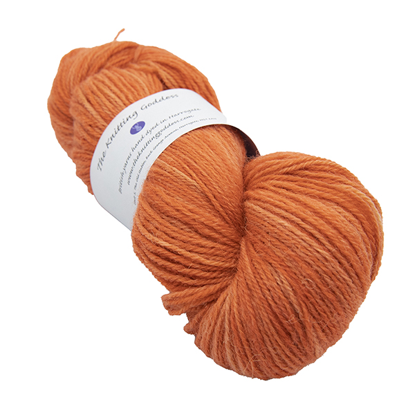skein of copper orange colour hand dyed Britsock yarn from The Knitting Goddess with ball band