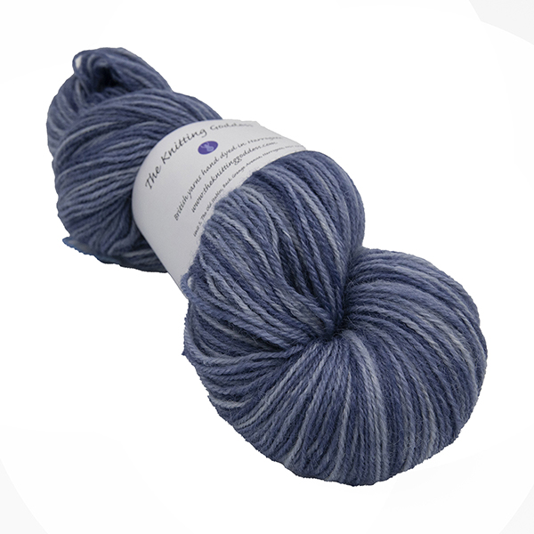 skein of dark slate blue colour hand dyed Britsock yarn from The Knitting Goddess with ball band