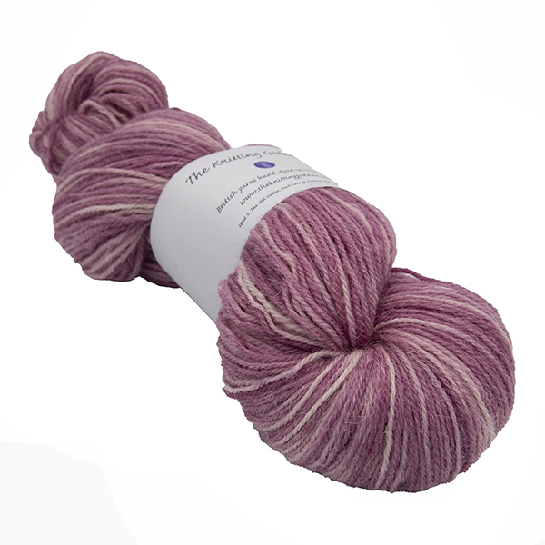 skein of dog rose pink colour hand dyed Britsock yarn from The Knitting Goddess with ball band