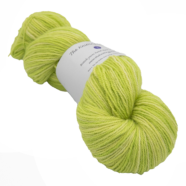 skein of bright lime green colour hand dyed Britsock yarn from The Knitting Goddess with ball band