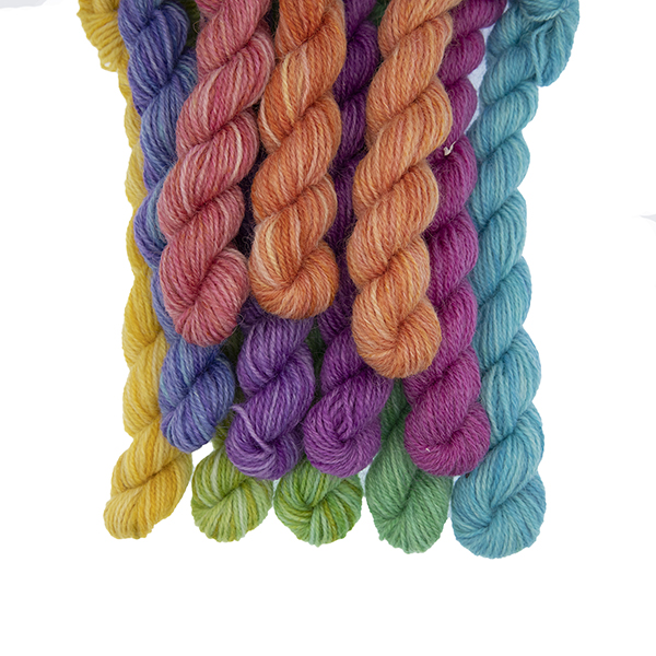 Set of twelve semi solid colours of Britsock mini skeins making up a colour wheel of 12 printer ink hues