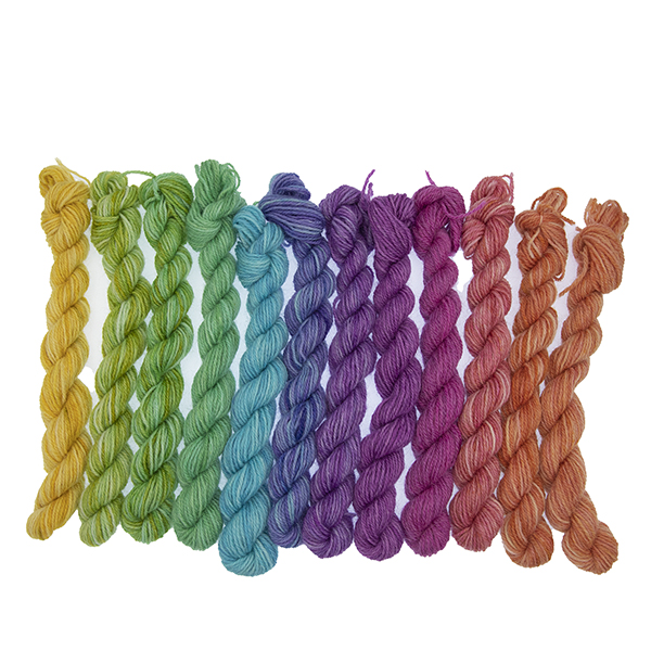 Set of twelve semi solid colours of Britsock mini skeins making up a colour wheel of 12 printer ink hues displayed as a line