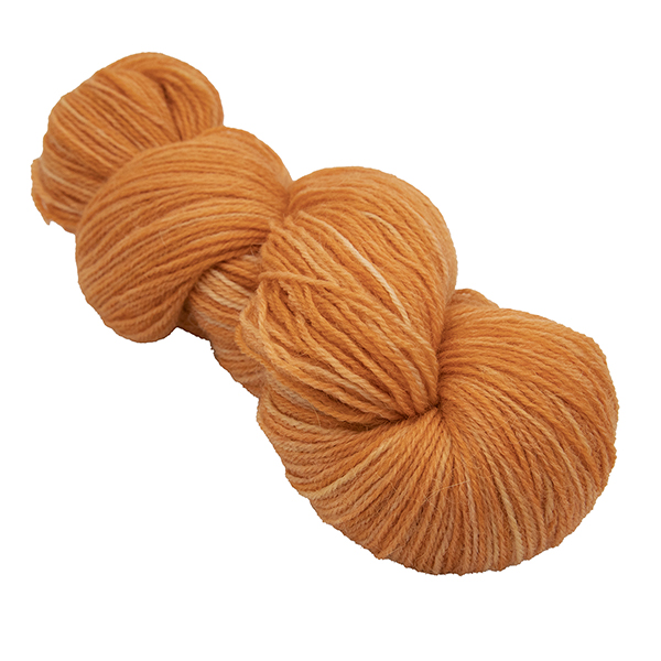 skein of marmalade orange colour hand dyed Britsock yarn from The Knitting Goddess