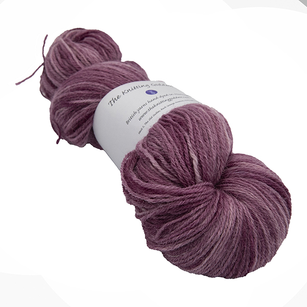 skein of plum colour hand dyed Britsock yarn from The Knitting Goddess with ball band
