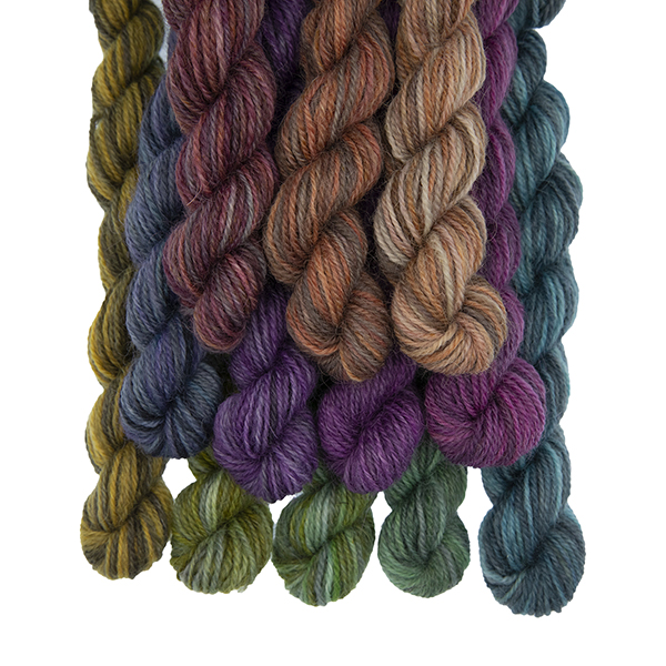 Set of twelve semi solid colours of Britsock mini skeins making up a colour wheel of 12 printer ink shades displayed as a bundle
