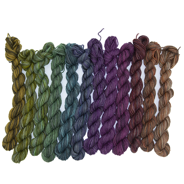 Set of twelve semi solid colours of Britsock mini skeins making up a colour wheel of 12 printer ink shades displayed as a line