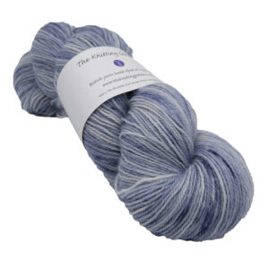 skein of pale slate blue colour hand dyed Britsock yarn from The Knitting Goddess with ball band