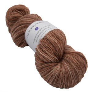 skein of toffee colour hand dyed Britsock yarn from The Knitting Goddess with ball band