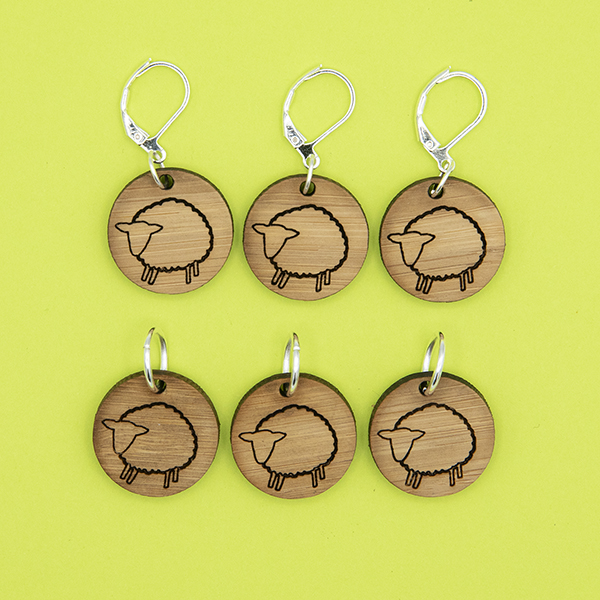 bamboo disc stitch markers engraved with sheep. set of six. lime green background.