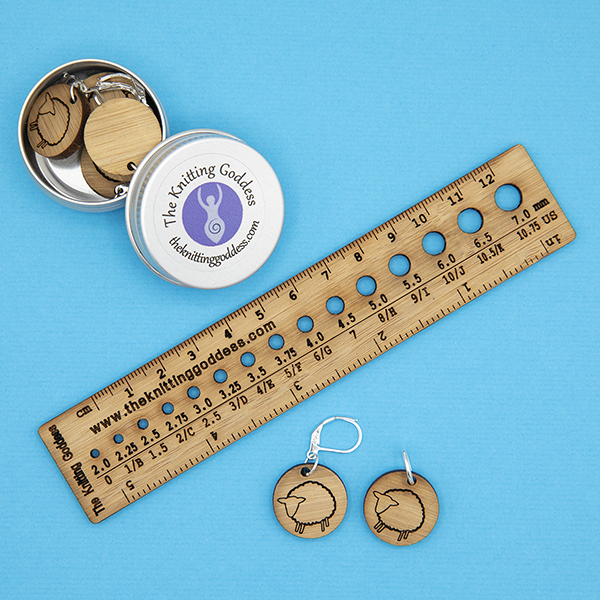 tin with bamboo disc stitch markers, engraved with sheep design , plus ruler and needle gauge