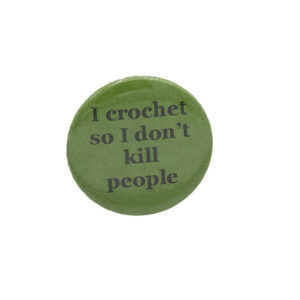 Green button badge with black writing which reads I crochet so I don't kill people