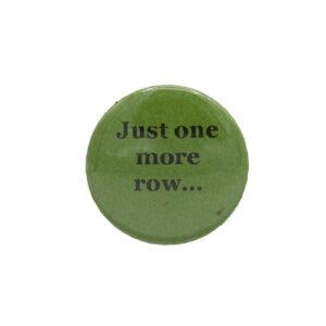 Green button badge with black writing which reads Just one more row...