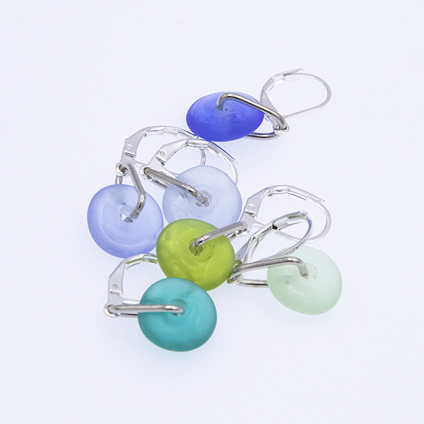 six blue and green glass stitch markers in a bundle