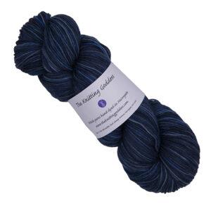 skein of darkest blue hand dyed yarn with The Knitting Goddess label