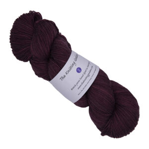 skein of darkest red hand dyed yarn with The Knitting Goddess label