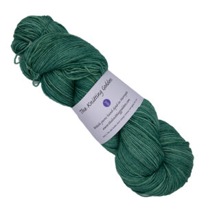 skein of green hand dyed yarn with The Knitting Goddess label